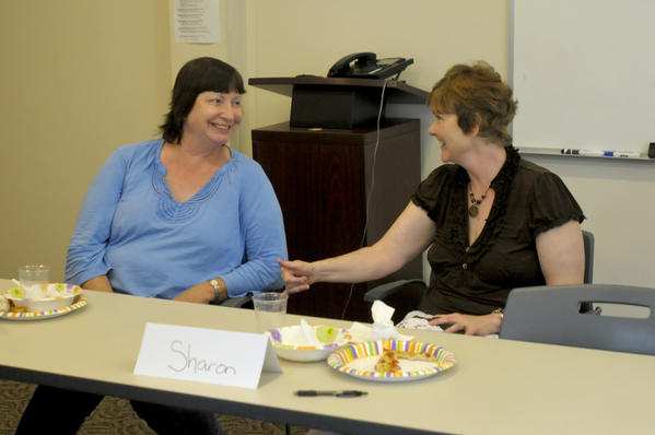 Sharon Scully, 57, (at right) shares stories with Bonnie, 57, (who declined to give her last name) about travels to Hawaii at a recent support group meeting for patients with early stage younger onset of Alzheimer's Disease. The group meets at the Connecticut chapter of the Alzheimer's Association in Rocky Hill.
