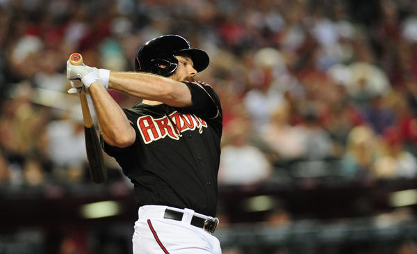 The Diamondbacks' Jason Kubel singles against the Rockies.