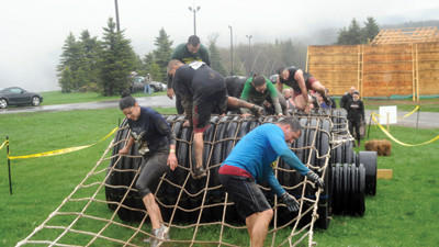 Participants work their way through the Recluse Rooster obstacle during the Mud on the Mountain event held in May.