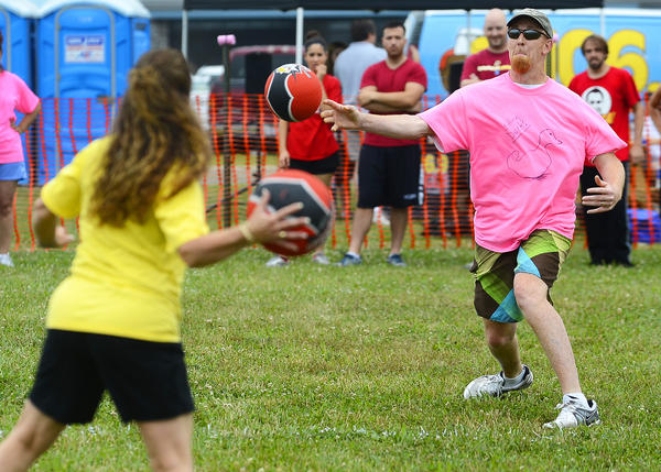 "Steven Nystrom, right, who played for the Children in Need Inc., team ""Sitting Ducks,"" throws a ball at Sheila Gladfelter, left, of the ""Hub City Lindyhop"" team to win the first game of the day Saturday morning at Hagerstown Regional Airport. The dodge ball tournament was a benefit for Hagerstown Aviation Museum, REACH Caregivers and Children in Need."