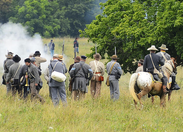 Confederate re-enactors fire at Union re-enactors Saturday morning during The Wagoner's Fight of July 6, 1863, in a field near Milestone Terrace in Williamsport.