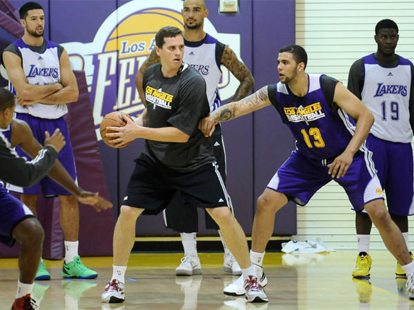 Mark Madsen helps out with the Lakers summer league camp invitees on July 10 at Toyota Sports Center in El Segundo.