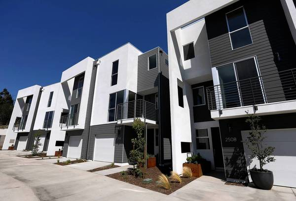A cluster of homes in Echo Park developed by Planet Home Living is part of a building boom of tiny proportions. Developers are marketing the modern homes in trendy areas to young professionals.