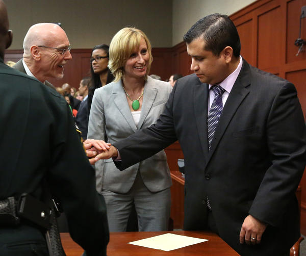 George Zimmerman is congratulated by his defense team after being found not guilty, on the 25th day of Zimmerman's trial at the Seminole County Criminal Justice Center, in Sanford, Fla. on Saturday.