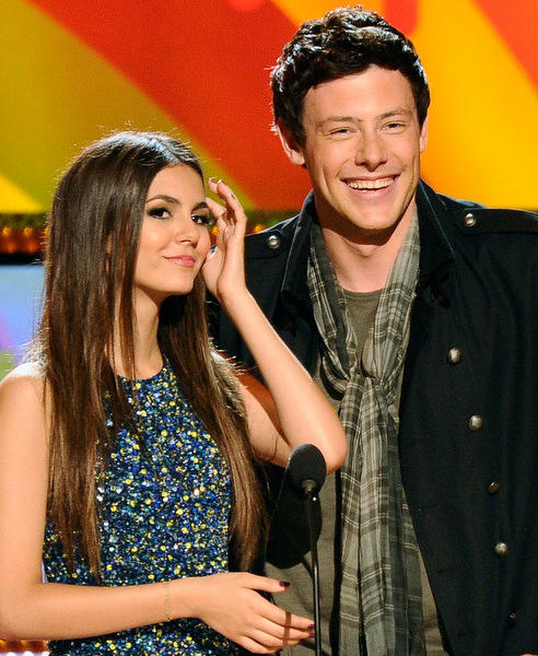 Actress/Singer Victoria Justice and actor Cory Monteith stand at the podium onstage during Nickelodeon's 24th Annual Kids' Choice Awards at Galen Center on April 2, 2011 in Los Angeles, California.