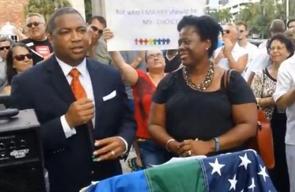 Florida Senate Democratic Leader Chris Smith and his wife Desorae Giles appear at rally in Fort Lauderdale in support of same-sex marriage.