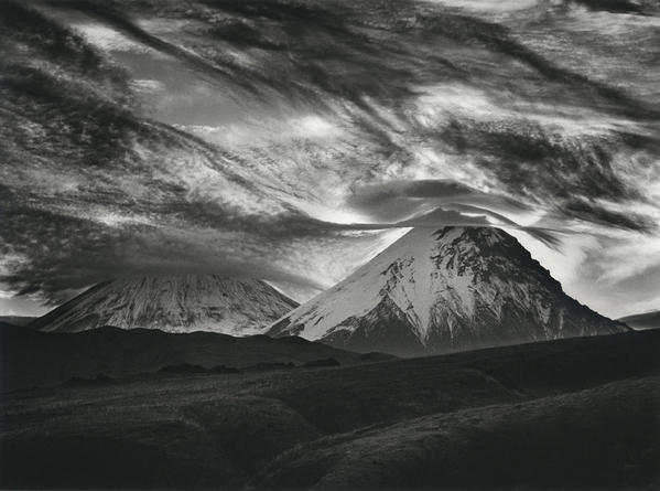 A photograph of volcanoes in Kamchatka, Russia, is included in the exhibition at Peter Fetterman Gallery.