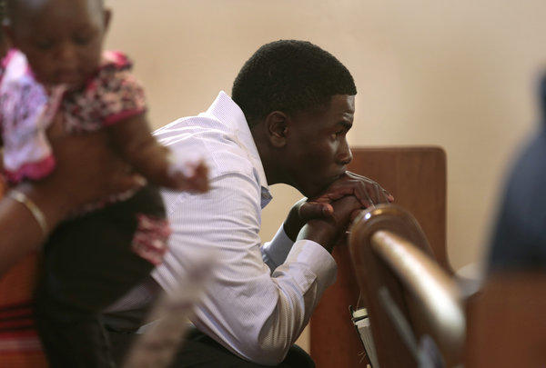 Kameron Brown, 14, attending services at Allen Chapel AME Church in Sanford, Fla., on Sunday, the day after George Zimmerman was found not guilty in the shooting death of Trayvon Martin.