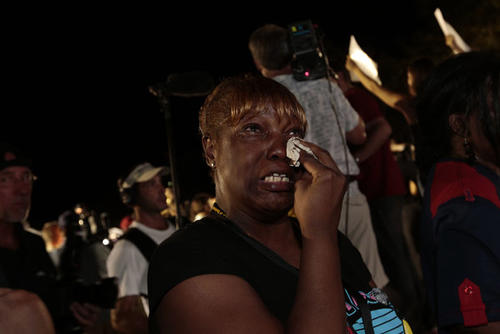 Tonnetta Foster of Sanford, Fla., is stunned by the verdict.