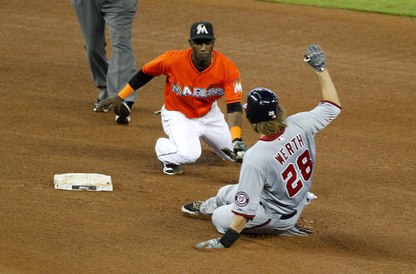 Jul 14, 2013; Miami, FL, USA; Miami Marlins shortstop Adeiny Hechavarria (3) tags out Washington Nationals first baseman Adam LaRoche (25) on a throw from right fielder Giancarlo Stanton (not pictured) at Marlins Park. Mandatory Credit: Robert Mayer-USA TODAY Sports ORG XMIT: USATSI-123150