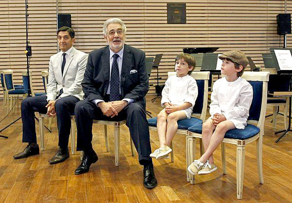 Placido Domingo, released from hospital,  speaks to reporters in Madrid.