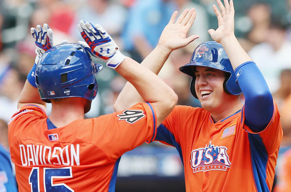 Angels prospect C.J. Cron congratulates Matt Davidson after his home run in the fourth inning of the Futures game Sunday at Citi Field.