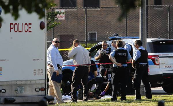 Chicago police investigate a body with gunshot wounds at Willye B. White Park, 1610 W. Howard Street, in Chicago.