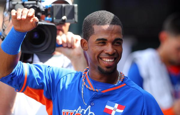 World infielder Arismendy Alcantara celebrates in the dugout after hitting a solo home run during the 2013 All-Star Futures Game at Citi Field.