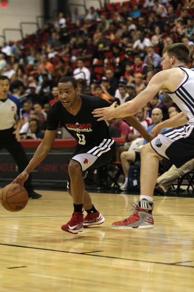 Bulls guard Andrew Goudelock dribbles the ball away from Grizzlies defender Jack Cooley during the first half of an NBA Summer League game at Cox Pavilion.