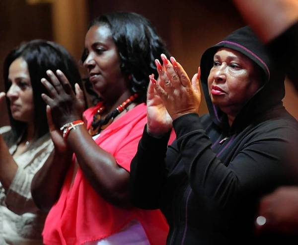 Parishioners applaud Sunday at Trinity United Church of Christ. The Rev. Otis Moss III, Trinity's senior pastor, spoke to his congregation about Saturday's acquittal of George Zimmerman, who was charged with murder after fatally shooting black teenager Trayvon Martin in Florida last year.