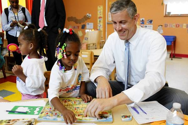 "Education Secretary Arne Duncan visits a Louisville, Ky., school last month. ""I actually use the California model, and not in a good way, as I travel the country,"" he said."