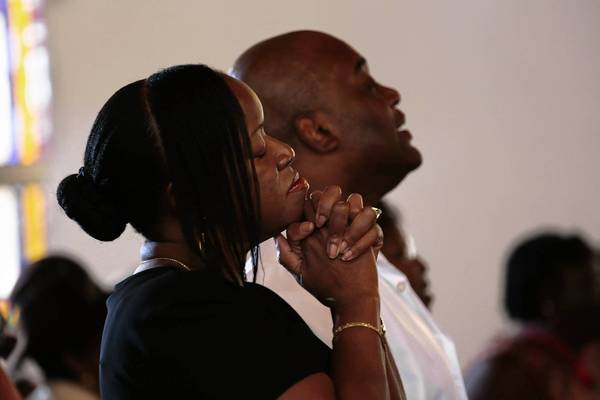 Supporters of Trayvon Martin's family attend church in Sanford, Fla.