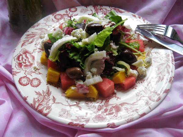 For a refreshing summer meal, combine greens and fruit, a little cheese or leftover poultry for protein atop a spring mix lettuce blend paired with cubed watermelon and mango, sliced fennel and kalamata olives.