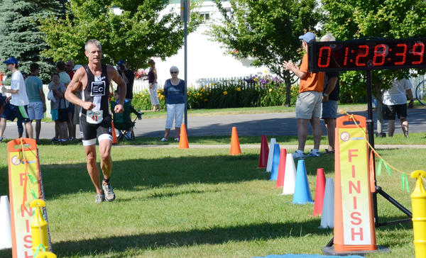 Craig Webb of Traverse City won the male overall title Sunday at the Little Traverse Triathlon as he finished in 1 hour, 23 minutes and 42.7 seconds.