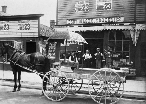 Bert Mason's grocery store and delivery wagon on Bridge Street, where East Park is today.