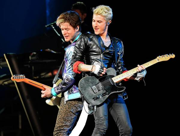 Guitarist Nash Overstreet, left, and singer/guitarist Ryan Follese of Hot Chelle Rae perform as the band opens for Justin Bieber at the MGM Grand Garden Arena on June 28 in Las Vegas, Nevada.