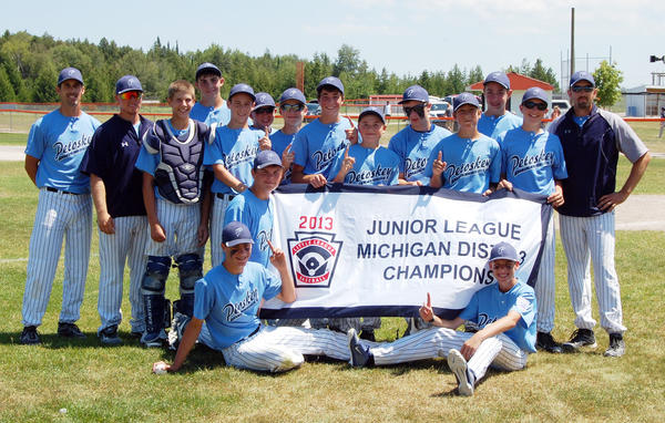 The Petoskey Junior Division (ages 13-14) tournament team captured the District 13 tournament title as they defeated Sault Ste. Marie, 17-6, in the title game Sunday in Rogers City. Team members are front (from left), Tyler Flynn, Buddy Gray, Reed Moore; back, coach Dan Wilcox, manager Dennis Kan, Nick Hartson, Jordan Conklin, Sam Wilcox, Doug Daniel, Tyler Adams, Peter Fila, Bren Lyons, Travis Buchanan, Jack Warner, Trevor Daniel, Seth Izzard and coach Eric Spencer.
