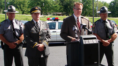 Sgt. Greg Keefer, Somerset station commander, from left; Capt. Michael Patrick, assistant director Bureau of Patrol; Thomas Prestash, District Executive Pennsylvania Department of Transportation District 9; and Trooper First Class Gregg Norton.