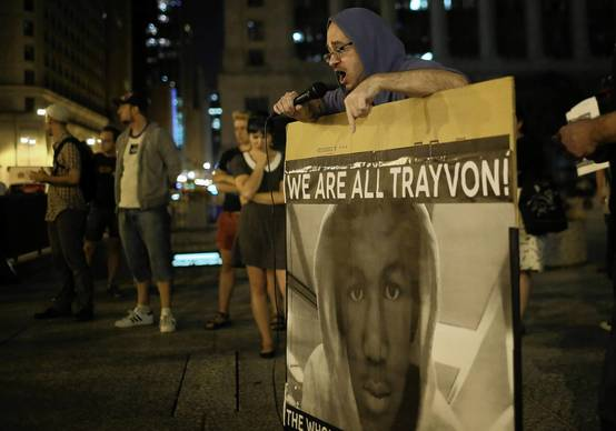A man speaks during a Daley Plaza protest of the acquittal of George Zimmerman in the death of Trayvon Martin.