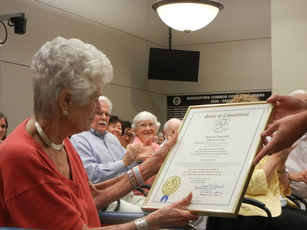 Katchen Coley, left, receives a state citation at a special common council meeting in Middletown July 11.