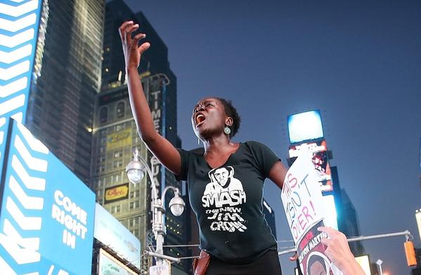 Trayvon Martin supporters rally in Times Square in New York City after George Zimmerman was acquitted of all charges in the shooting death of Martin.