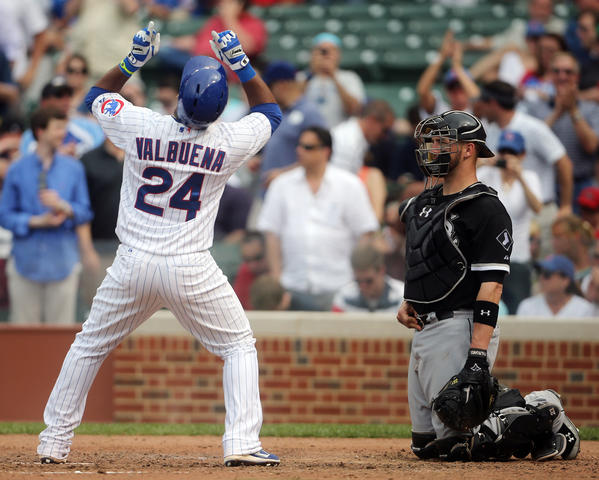 White Sox catcher Tyler Flowers (right) waits while Cubs third baseman Luis Valbuena celebrates his solo home run May 30 at Wrigley Field.