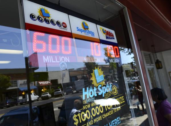A digital sign at a doughnut store in Oakland displays lottery jackpots after California joined the Powerball game.