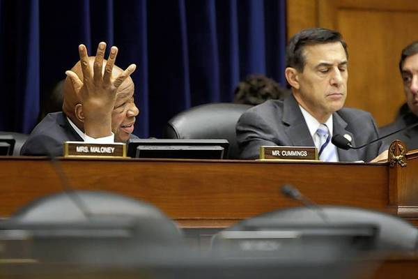 Ranking member Rep. Elijah Cummings (D-MD) (L), seated with committee chairman U.S. Representative Darrell Issa (R-CA).