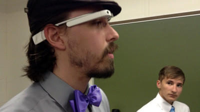 Mark Dewey, a software engineer at Problem Solutions, demonstrates an advanced pair of Google Glass, a wearable computer. The Johnstown firm is partnering with The Learning Lamp to offer an advanced technology camp to 16 students this summer.