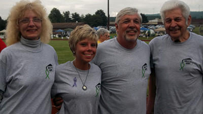 Chalyce Howsare, 22, of Meyersdale (center) is pictured with her family (from left) Judy, Denny and grandfather, Paul. The younger Howsare bravely told her story of surviving Stage 2 Hodgkin's Lymphoma during the Friday evening ceremony of Meyersdale Relay for Life.