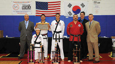 Grand Champions of the third annual Team Millers Martial Arts Championships were held June 15 at Richland High School. Front row, left to right: Katie Clegg, jr. black belt weapons and forms; Dakota Martinez, adult black belt weapons; and Master David Gemberling, adult black belt forms. Back row, left to right: Master Christopher Miller, Chief Instructor, Master Matt Kim, Jeremy Mostoller and Master Adam Marsh.