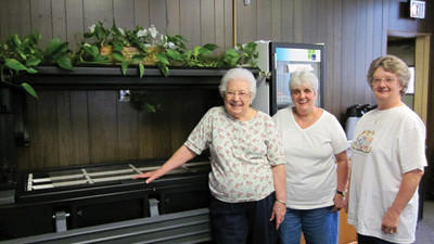 Seniors Agnes Palya, Theresa Alexander and Ila Jean Custer, check out the server where Cafe menus will soon be available to the public.