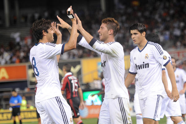 Real Madrid players celebrate a goal by Sergio Ramos (4) against AC Milan during the second half at Yankee Stadium. Real Madrid won the game 5-1.