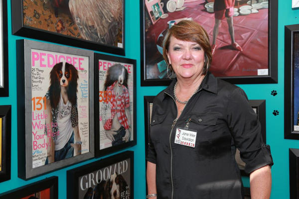 "Jane Davidian, from Arkansas, showcasing her ""Celebrity Dog"" paintings at Art-A-Fair."
