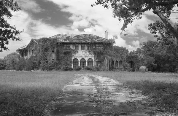 Old, abandoned or historic buildings and vehicles dot the Central Florida landscape. This is the vacant historic Howey mansion in Howey-in-the-Hills.