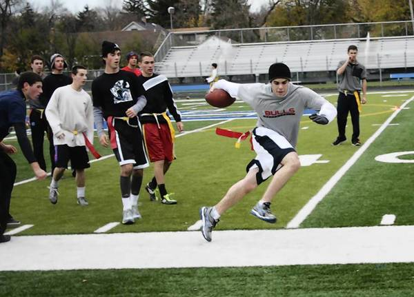 Students take part in an intramural flag football game sponsored by Highland Park nonprofit group Nova.