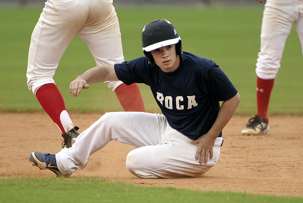 Boca Raton Lightning's Darren Zaslau, from Pennsylvania, gets tagged out before reaching second base during a South Florida Collegiate League game against the South Florida Huskies, Wednesday, July 3, 2013 at Fort Lauderdale's Northeast High School. Michael Laughlin, South Florida Sun Sentinel