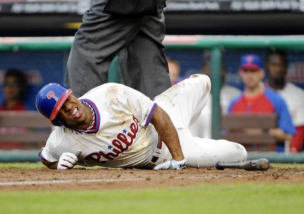 Philadelphia Phillies center fielder Ben Revere lays on the ground after fouling the ball off his foot in the 11th inning Saturday against the Chicago White Sox.