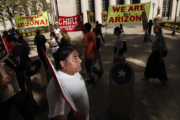 Alex Melendez marches with Immigration rights supporters and members of the Coalition for Humane Immigrant Rights of Los Angeles during a rally in response to the U.S. Supreme Court ruling on Arizona's immigration law, SB 1070, outside the Federal Court Building in downtown Los Angeles last summer.