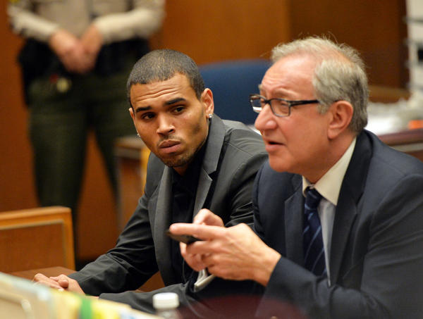 Chris Brown, left, and his attorney Mark Geragos appear during a hearing at Los Angeles County Superior Court.