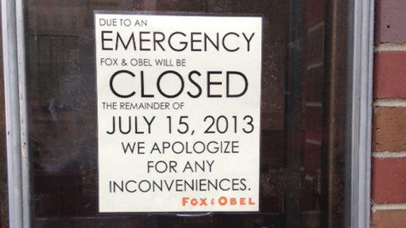 A sign on the door of Fox & Obel tells of the store's closure Monday.