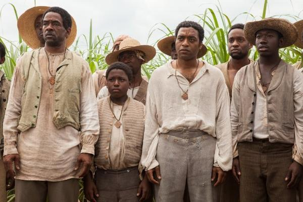 "Chiwetel Ejiofor, center, in ""12 Years a Slave."""