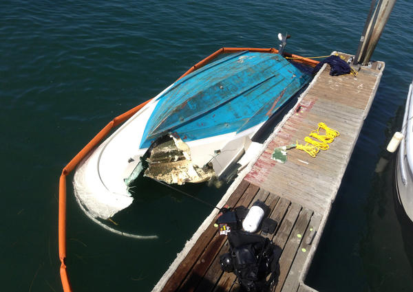 One of the boats involved in a two-vessel collision in Newport Harbor is recovered Monday.
