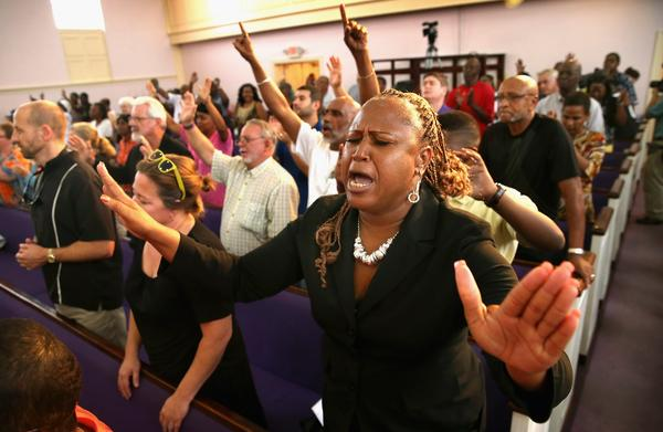 Residents of Sanford, Fla., attend a prayer vigil to promote peace and unity in the community in the wake of the George Zimmerman trial on Monday.